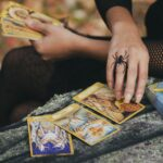 Hands with spider ring and tarot cards